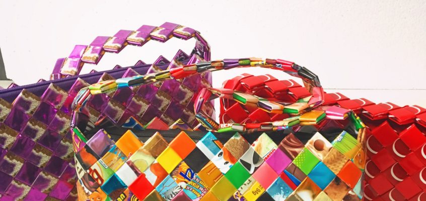 Now available at the ISDF online store candy wrapper Purses!